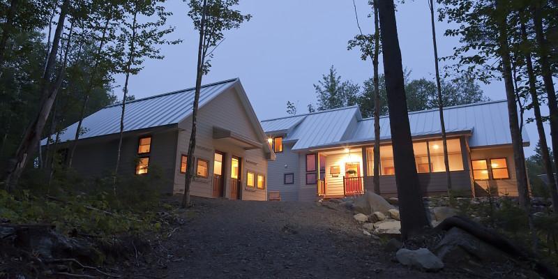 Poplar Hut exterior at night