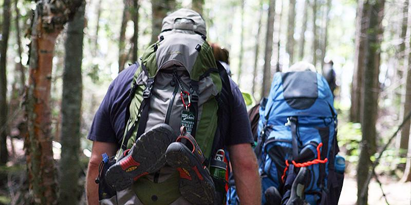 Hikers with full backpacks