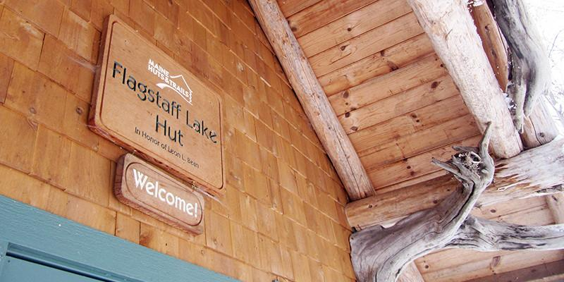 Welcome sign at Flagstaff Lake Hut